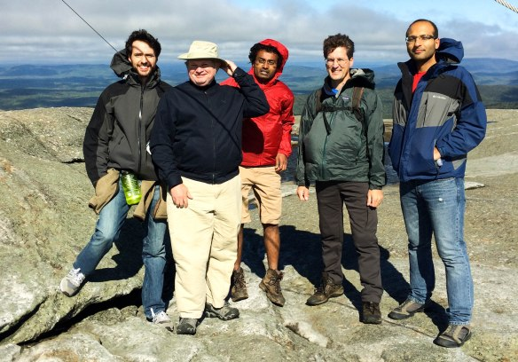 THaW hikers atop Mount Cardigan on a blustery NH day (AJ, Carl, Shrirang, David, Faraz).