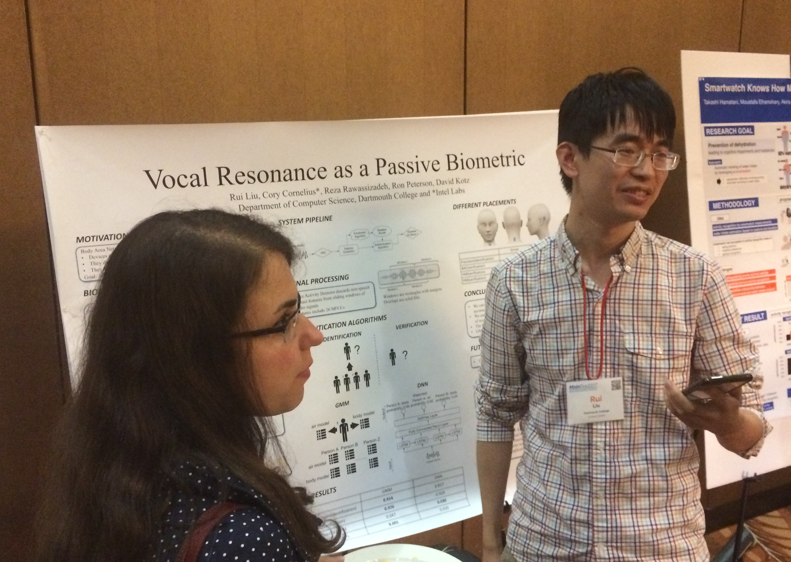 Rui Liu explains his poster to attendees at ACM MobiSys'17.